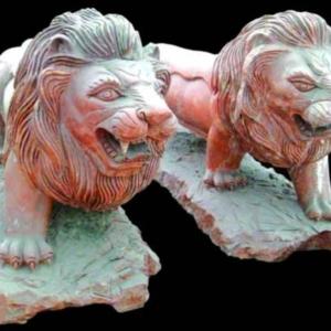 Скульптуры львов и тигров